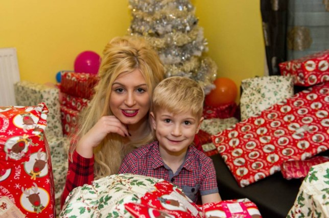 PIC BY JAMES NEWALL/ CATERS NEWS - (PICTURED: Megan with Ashton, 7, with all of the christmas presents) - A mum who was determined to give her son the best Christmas ever has paid for his pile of presents - by starring in a series of PORN flicks. Pretty Megan Clara, 20, was gutted last year when her son Ashton, five, complained that he didnt receive the same expensive presents as his mates. The single mum, who survived on 80 a week, had only managed to afford to buy him an Etch A Sketch, cuddly toys and new clothes. But after seeing his disappointed face, she vowed to make Christmas 2015 one to remember - and has spent the year making adult films, earning 500 a scene, to give her family a five-star festive celebration. SEE CATERS COPY.