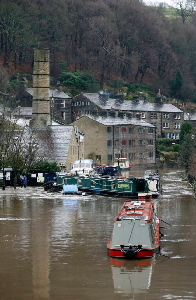 Canal boats in the River Calder in Hebden Bridge, West Yorkshire, where flood sirens were sounded after torrential downpours. PRESS ASSOCIATION Photo. Picture date: Saturday December 26, 2015. See PA story WEATHER Floods. Photo credit should read: Peter Byrne/PA Wire