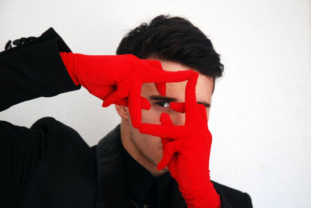 PIC FROM CATERS NEWS - (Pictured: Deaf Finger Dancer Andrey Dragunov, 24, wearing red gloves in a dancing position.) You would think this dancer may have difficulties in his profession given that he is deaf - but he is letting his FINGERS do the dancing. Russian mover Andrey Dragunov, 24, has perfected the art of finger tutting, which involves the movement of fingers to create shapes in a unique form of dance, having started when he was 15. This visually stunning and impressive form of dance can be seen as an innovative way for Andrey, from St Petersburg, to get around his hearing problems. SEE CATERS COPY.