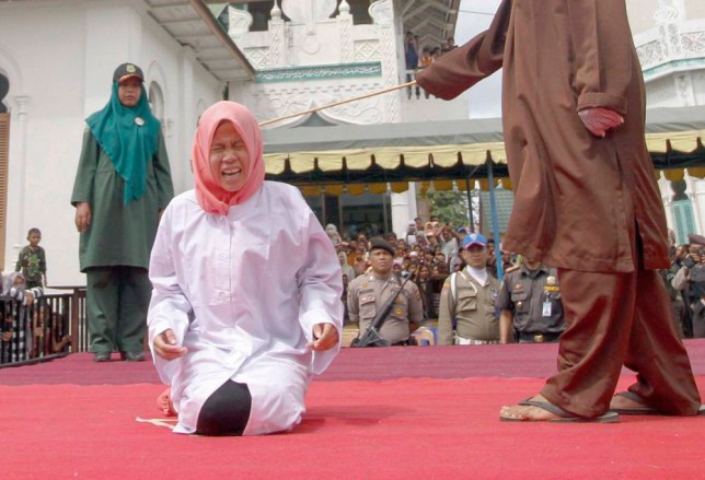 Image result for indonesian woman caned in public
