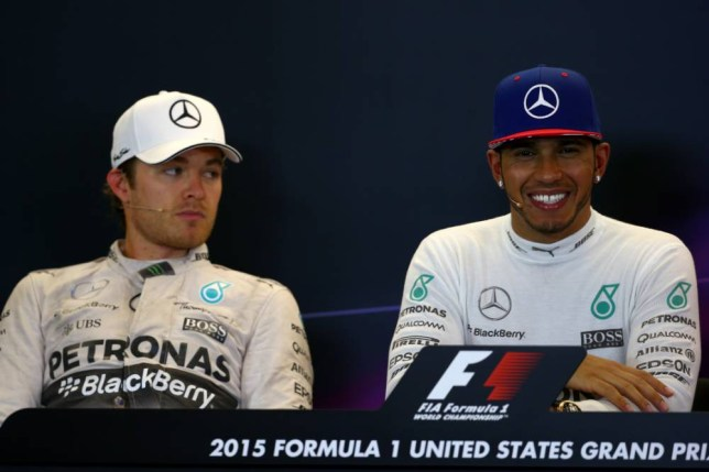Lewis Hamilton of Great Britain and Mercedes GP smiles next to a dejected Nico Rosberg of Germany and Mercedes GP in a press conference after winning the United States Formula One Grand Prix and the championship at Circuit of The Americas on October 25, 2015 in Austin, America. AUSTIN, TX - OCTOBER 25: (Photo by Mark Thompson/Getty Images)
