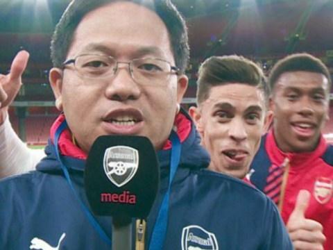 Arsenal's Gabriel Paulista and Alex Iwobi photobomb reporter at the Emirates