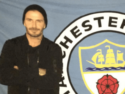 David Beckham proves he is still a Manchester United legend by knocking Manchester City flag