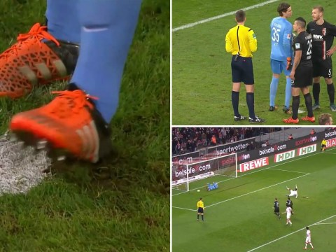 Augsburg keeper Marwin Hitz prevents striker from scoring by digging hole next to penalty spot