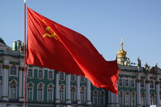 The flag of the USSR and the Winter Palace in St Petersburg (Picture: Getty Image)