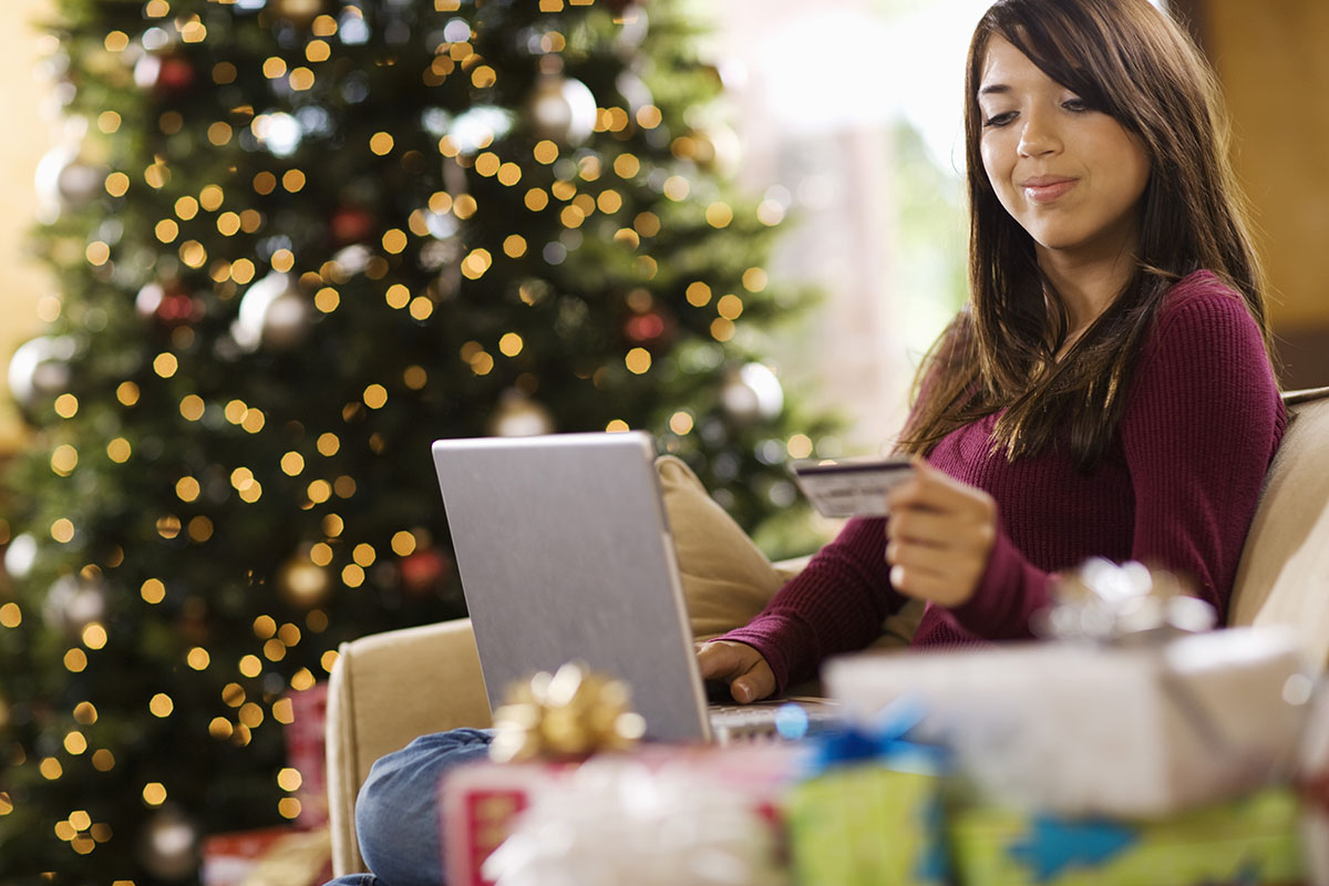 Teenage girl using laptop computer at Christmas Getty