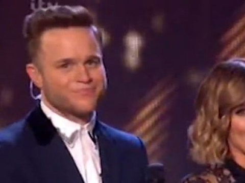 Olly Murs looks pretty upset after Rita Ora snubbed him on The X Factor