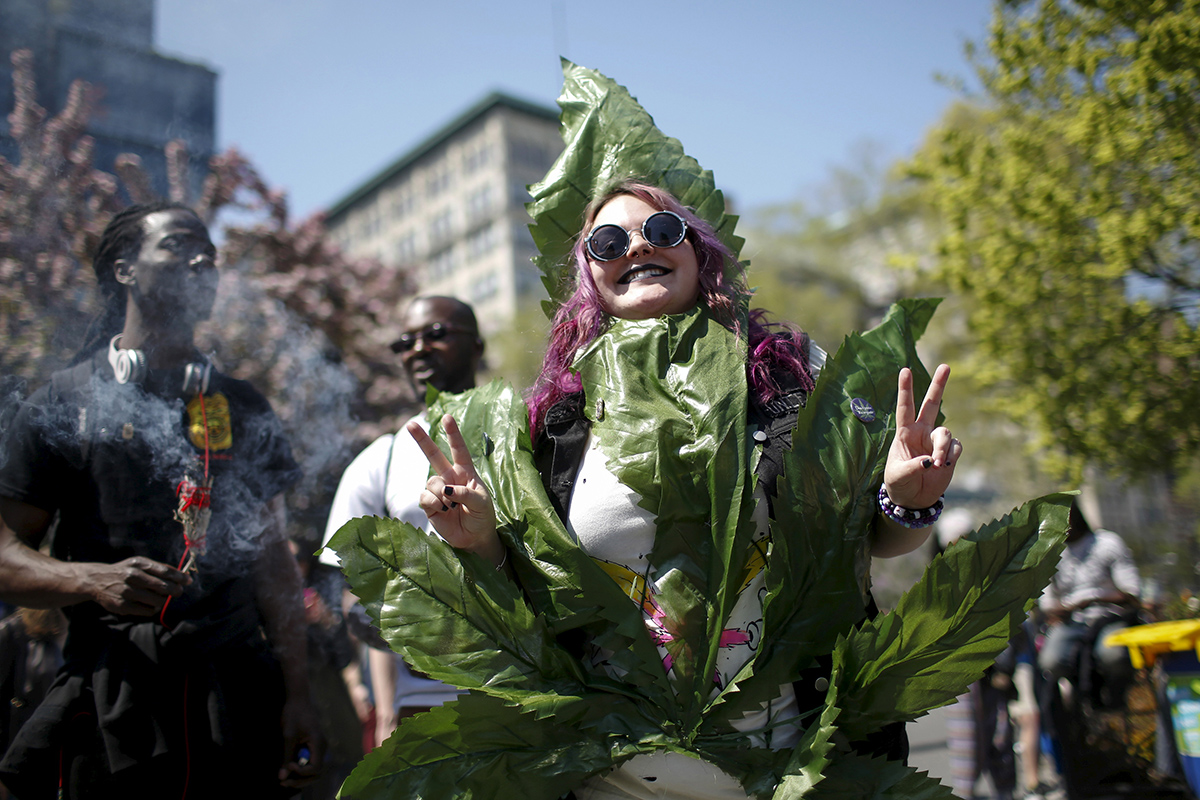 People take part in a rally calling for marijuana to be legalized, at Union Square in New York May 2, 2015. REUTERS/Eduardo Munoz - RTX1BA1B