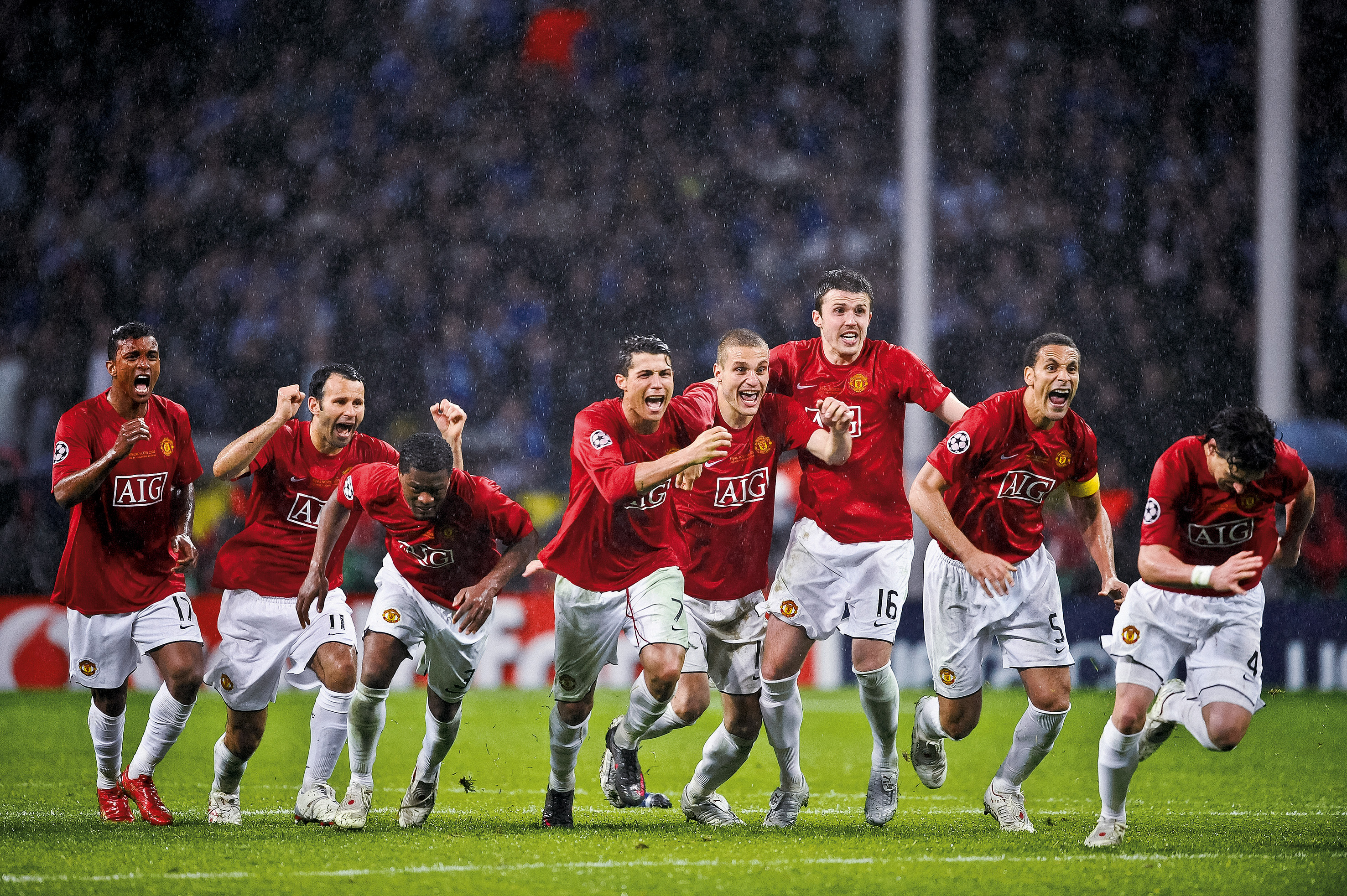 """Manchester United players celebrate the moment they win the penalty shoot-out against Chelsea in the Champions League Final at the Luzhniki Stadium on May 21st 2008 in Moscow, Russia (Photo by Tom Jenkins/Getty Images). An image from the book """"In The Moment"""" published June 2012"""
