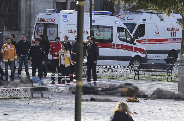 ATTENTION EDITORS - VISUALS COVERAGE OF SCENES OF DEATH OR INJURY Rescue teams gather at the scene after an explosion in central Istanbul, Turkey January 12, 2016. Turkish police sealed off a central Istanbul square in the historic Sultanahmet district on Tuesday after a large explosion, a Reuters witness said, and the Dogan news agency reported several people were injured in the blast. REUTERS/Kemal Aslan TEMPLATE OUT.