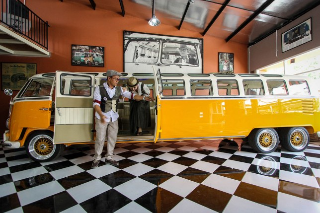 SEMARANG, INDONESIA - JANUARY 13: People gather around to check out the longest car Volkswagen Kombi van with a length of 7.6 meters and a width of 165 centimeters on January 13, 2016 in Semarang, Indonesia. Wahyu Pamungkas, 30, from Semarang, Indonesia and his workers have spent one year to create this car and has spent $ 28 837.89 (400 million IDR). He built the car by cut two of Volkswagen Kombi van put together by changing the chassis which is the internal framework on which to base the production of a car. As for the engine of 1,500 cc is then converted into a 2000 cc. In 2009 he has also been made of Volkswagen Combi van with a length of 6.9 meters which was later sold to an Australian citizen for $ 16 221.31 (225 million IDR). PHOTOGRAPH BY WF Sihardian / Barcroft Media UK Office, London. T +44 845 370 2233 W www.barcroftmedia.com USA Office, New York City. T +1 212 796 2458 W www.barcroftusa.com Indian Office, Delhi. T +91 11 4053 2429 W www.barcroftindia.com