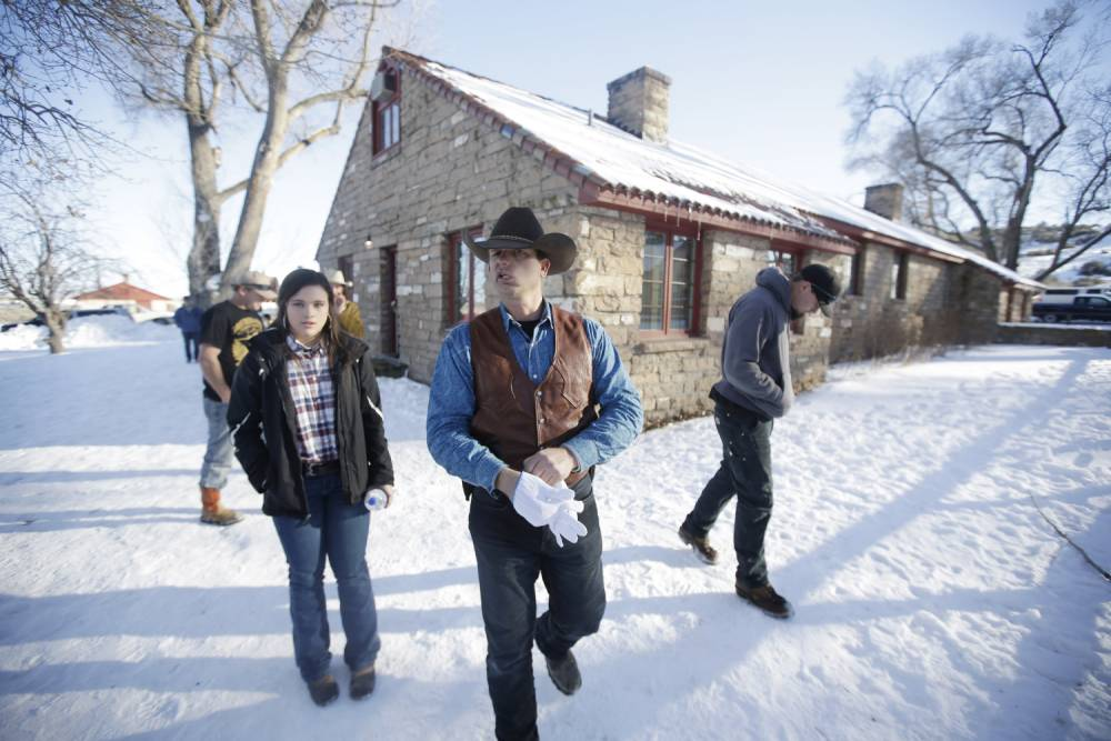 Ryan Bundy, one of the sons of Nevada rancher Cliven Bundy, walks through the Malheur National Wildlife Refuge Friday, Jan. 8, 2016, near Burns, Ore. The leader of a small, armed group occupying a national wildlife refuge in Oregon says the activists have no immediate plans to leave. (AP Photo/Rick Bowmer)