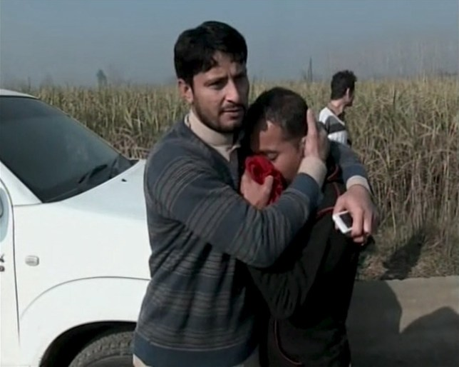 People react outside Bacha Khan University where an attack by militants took place, in Charsadda, northwestern Khyber Pakhtunkhwa province, Pakistan in this still image taken from a video January 20, 2016. REUTERS/Reuters TV