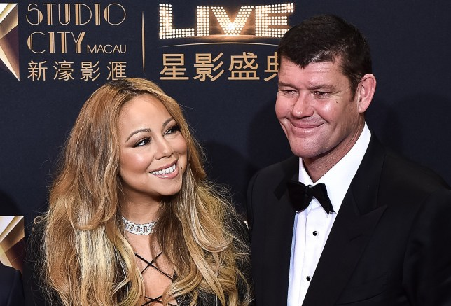 US singer Mariah Carey (L) looking at co-chairman of Melco Crown Entertainment, James Packer (R), as they stand on the red carpet ahead of the opening ceremony of the Studio City casino resort in Macau. US pop star Mariah Carey and Australian casino tycoon James Packer are engaged to be married, according to friends who said on January 22, 2016 they were over the moon for the lovebirds.