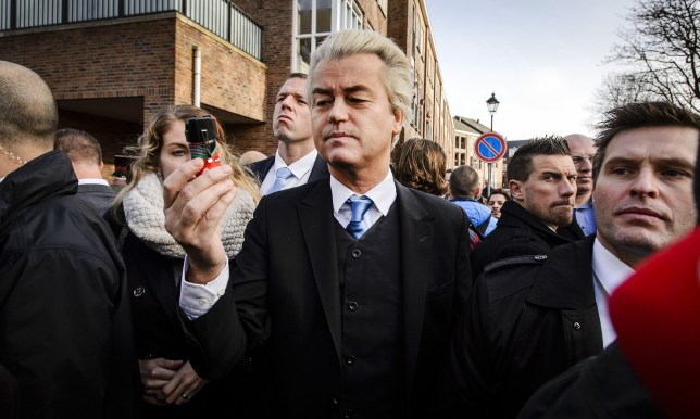 Dutch populist far-right Party for Freedom (PVV) leader Geert Wilders (C) distributes on January 23, 2015 in the center of Spijkernisse a color spray for women which they can use to prevent sexual assault, saying it was needed to protect Dutch women after the New Year's Eve assaults in Cologne, Germany. / AFP / ANP / Remko de Waal / Netherlands OUTREMKO DE WAAL/AFP/Getty Images