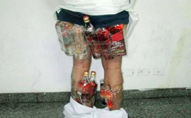 Pic shows: Local man arrested trying to smuggle liquor in his underwear.nnKnicker liqour tricker caught and facing jailnnA Saudi Arabian man caught with hard liqour in his underpants is facing the wrath of the authorities in his homeland.nnAlcohol is strictly forbidden in the Kingdom and offenders are routinely punished for breaking Koranic laws with long jail terms.nnThe man will also face a public lashing.nnMedia reports said the man was caught on the King Fahd causeway linking the country to Bahrain.nnBahrain is not a dry state and is a magnet for Saudi men who pour over the border for drunken binges.nnThe Saudi man was returning from Bahrain when he was stopped by customs officials. In total, under his long flowing body robes, he had 14 bottles of booze hidden in his underwear and tied to his body.nnThe problem of liver disease among Saudis who break for the Bahraini border has become so acute that trained liver specialists are recruited from the UK, America and Europe on high salaries to treat them in state-of-the-art hospitals.nnOften the authorities turn a blind eye to expatriates drinking in the Kingdom, especially if they live in sealed quarters away from the general population.nnThe unwritten rule is that the drinking takes place behind closed doors and locals are not involved in it.nn Another smuggling route is from Jordan where spirits are available, and where some of it is manufactured, like beer and a spirit known as Araq.nnThose with a smaller budget resort to buying homemade alcohol, or make it themselves using grapes or dates. Occasionally, there are reports about the discovery of factories for making alcoholic beverages.nn(ends)n