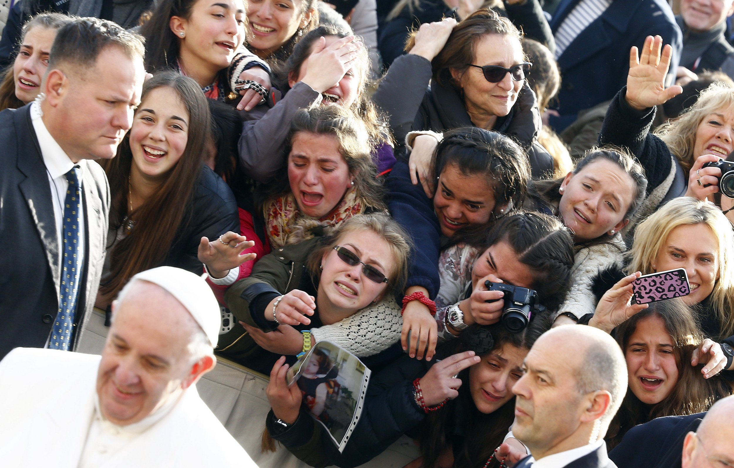 Faithful greet Pope Francis as he arrives to lead the weekly audience in Saint Peter's Square at the Vatican, January 27, 2016. REUTERS/Tony Gentile