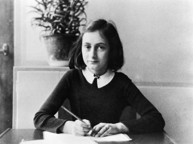 (GERMANY OUT) ' Anne Frank, German Jew who emigrated with her family to the Netherlands during the Nazi era. Separated from the rest of her family, she and her sister died of typhoid fever in the concentration camp Bergen-Belsen - As a 12-year old doing her homework - 1941 (Photo by ADN-Bildarchiv/ullstein bild via Getty Images)
