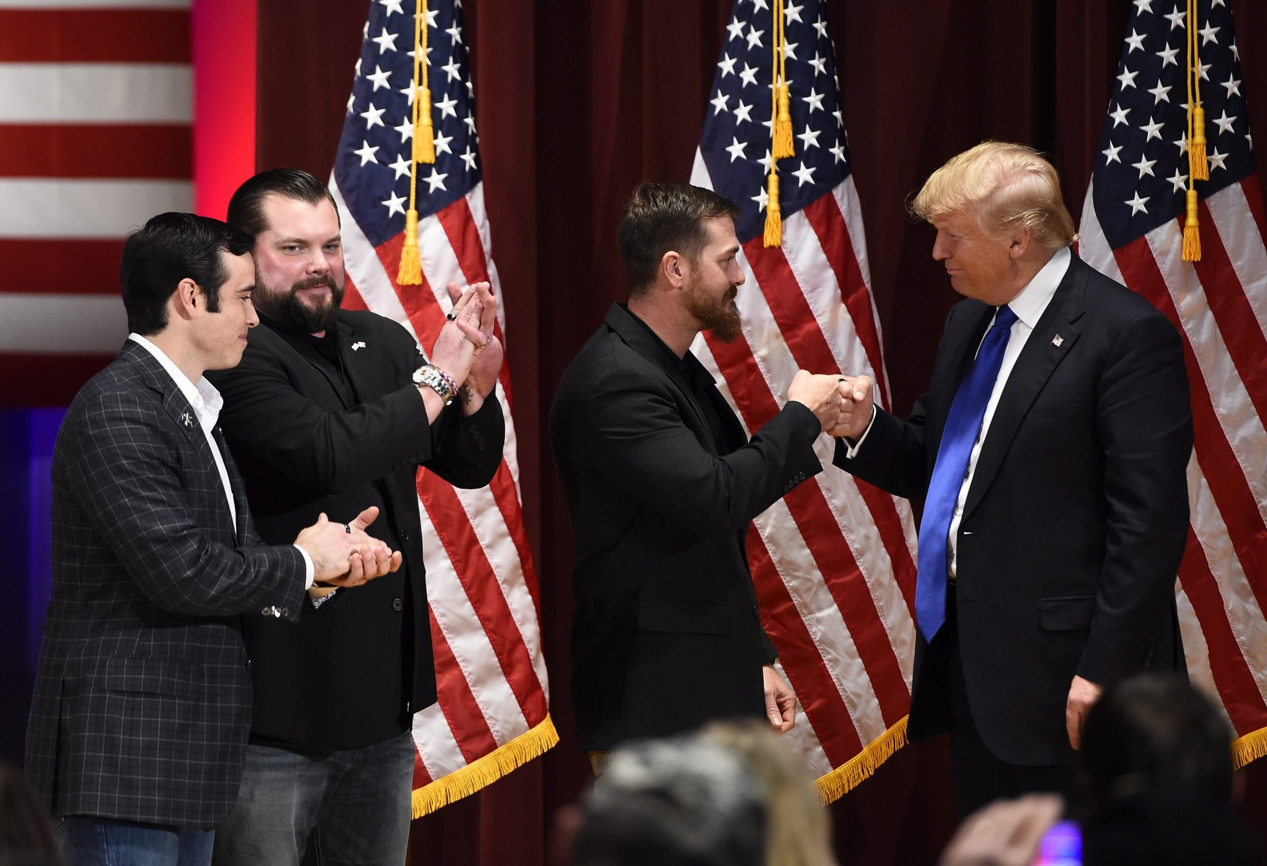 epaselect epa05132481 Three veterans give Businessman and Republican presidential candidate Donald Trump (R) a 22 Kill Honor Ring that represents twenty two veterans that kill themselves daily by suicide during a rally on the Drake University campus at a special event to benefit veterans after skipping the Fox News GOP debate in Des Moines, Iowa, 28 January 2016. The Iowa Caucus will be held 01 February 2016 and is the first official test of candidates seeing their parties nominations. EPA/LARRY W. SMITH