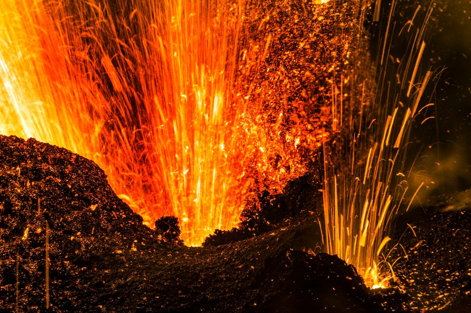 PIC BY LUC PERROT/ CATERS NEWS - (PICTURED: The powerful erupting volcano) - Unb-lava-ble! This amazing collection of images showing spectacular volcanic eruptions will blow you away. It looks like a scene from a film the incredible footage shows a volcanic eruption as youve never seen it before. The stunning images show the red-hot lava shooting straight out of the volcano in super high definition, sending sparks flying and lighting up the sky with a red glow. The photos were taken at the Piton de la Fournaise volcano on Reunion Island, a French island in the Indian Ocean one of the most active volcanoes in the world. SEE CATERS COPY.