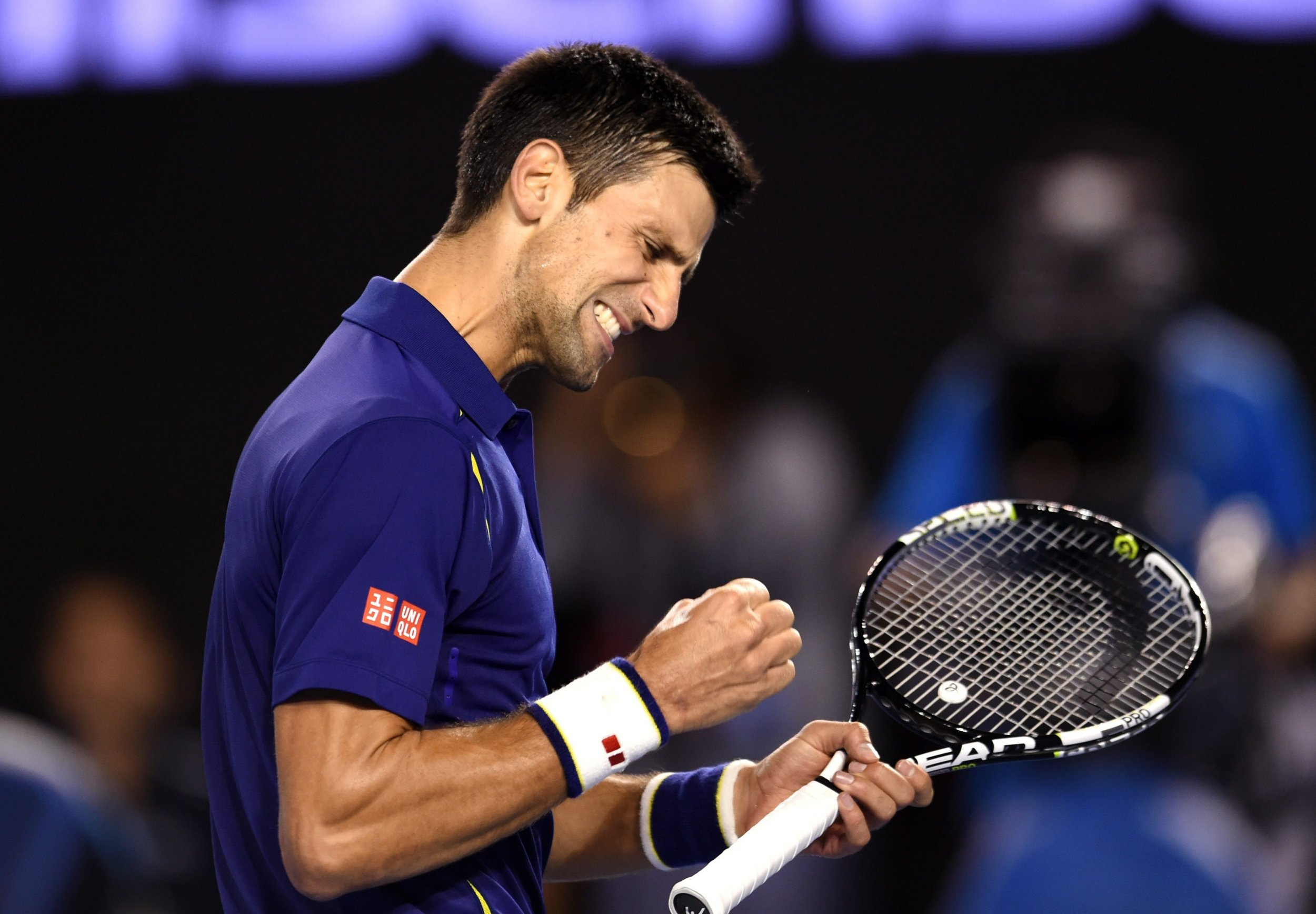 epa05136630 Novak Djokovic of Serbia reacts during his final match against Andy Murray of Britain at the Australian Open tennis tournament in Melbourne, Australia, 31 January 2016. EPA/FILIP SINGER