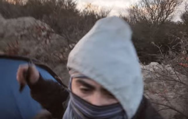 One refugee was armed with a knife (Picture: YouTube)