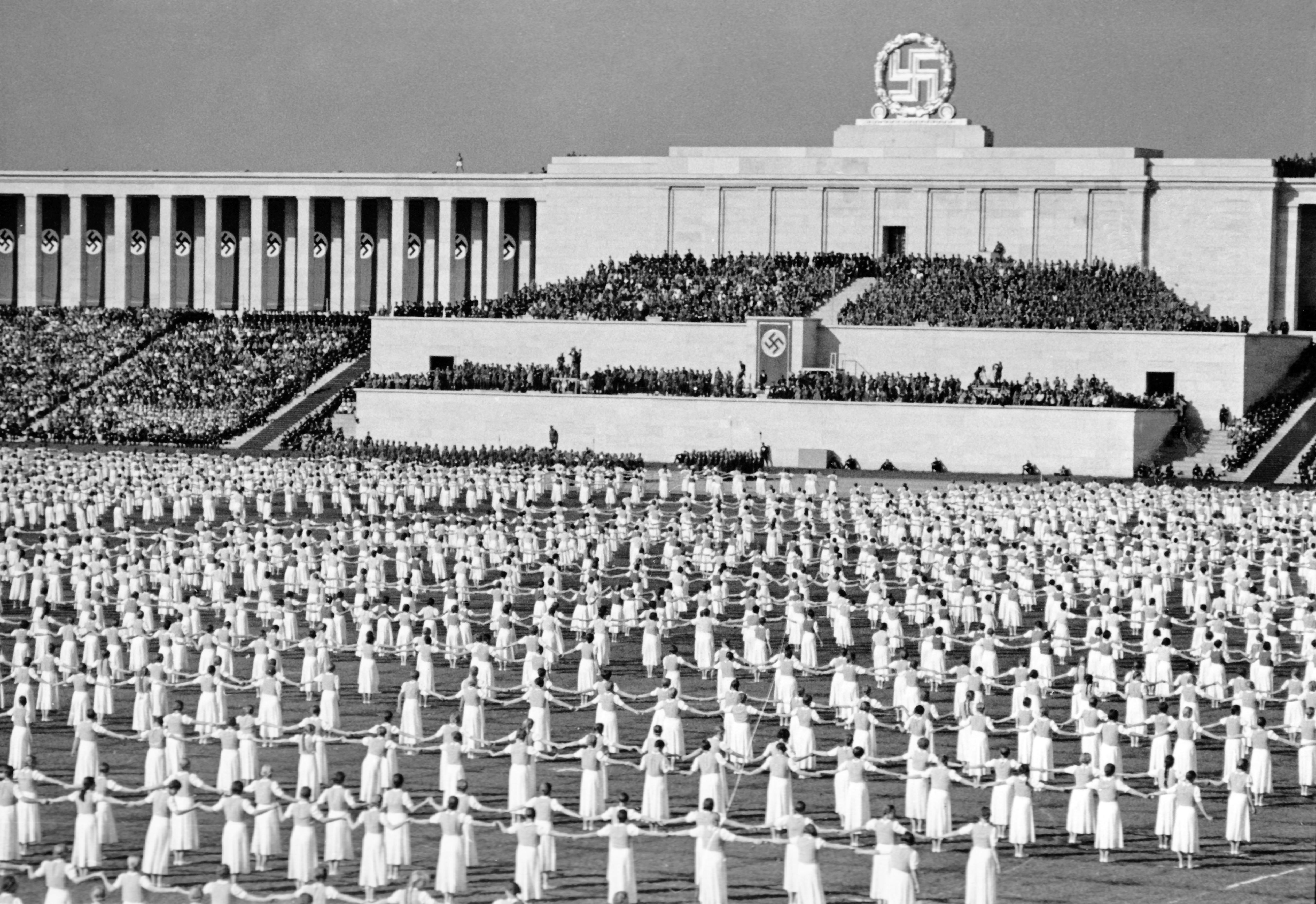E8PHX2 Nuremberg Rally in Nuremberg, Germany - Events on the occasion of 'Day of the Community' on Zeppelin Field, here 5,000 members of the League of German Girls (BDM) present folk dances. In the background the grandstand. (Flaws in quality due to the historic picture copy) Photo: Berliner Verlag/Archive - NO WIRE SERVICE - Credit: Alamy