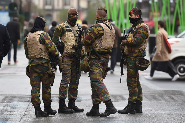 Soldiers patrol in the streets, in Brussels following the Paris attacks (Picture: Getty)