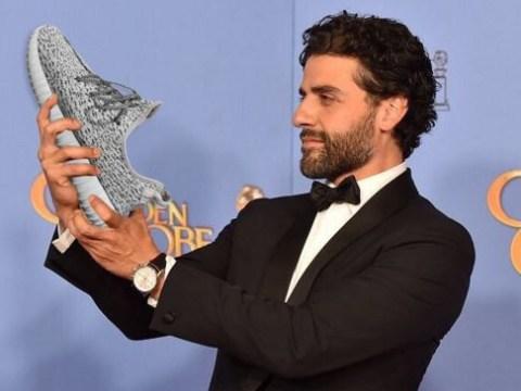 Oscar Isaac staring at his Golden Globe got the Kanye meme treatment