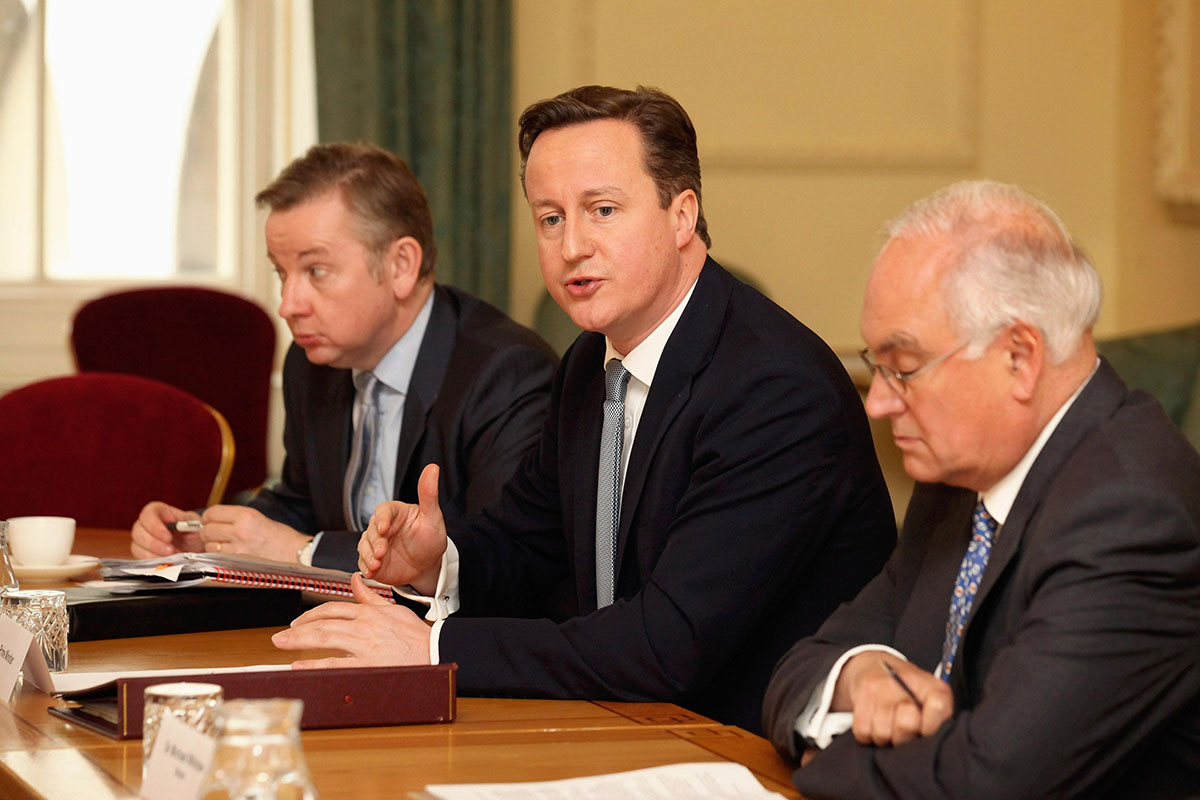 Prime Minister David Cameron (centre), Education Secretary Michael Gove (left) and Sir Michael Wilshaw attend a meeting on education at 10 Downing Street, London, with a group of headteachers with experience of turning schools around. PA