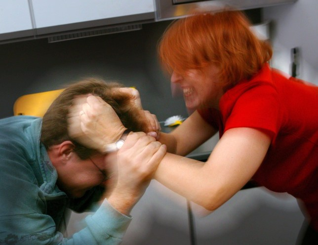Mandatory Credit: Photo by SAKKI/REX/Shutterstock (432208b) WOMAN BEATING UP A MAN AND PULLING HIS HAIR DOMESTIC VIOLENCE BY WOMEN AGAINST MEN - 2003
