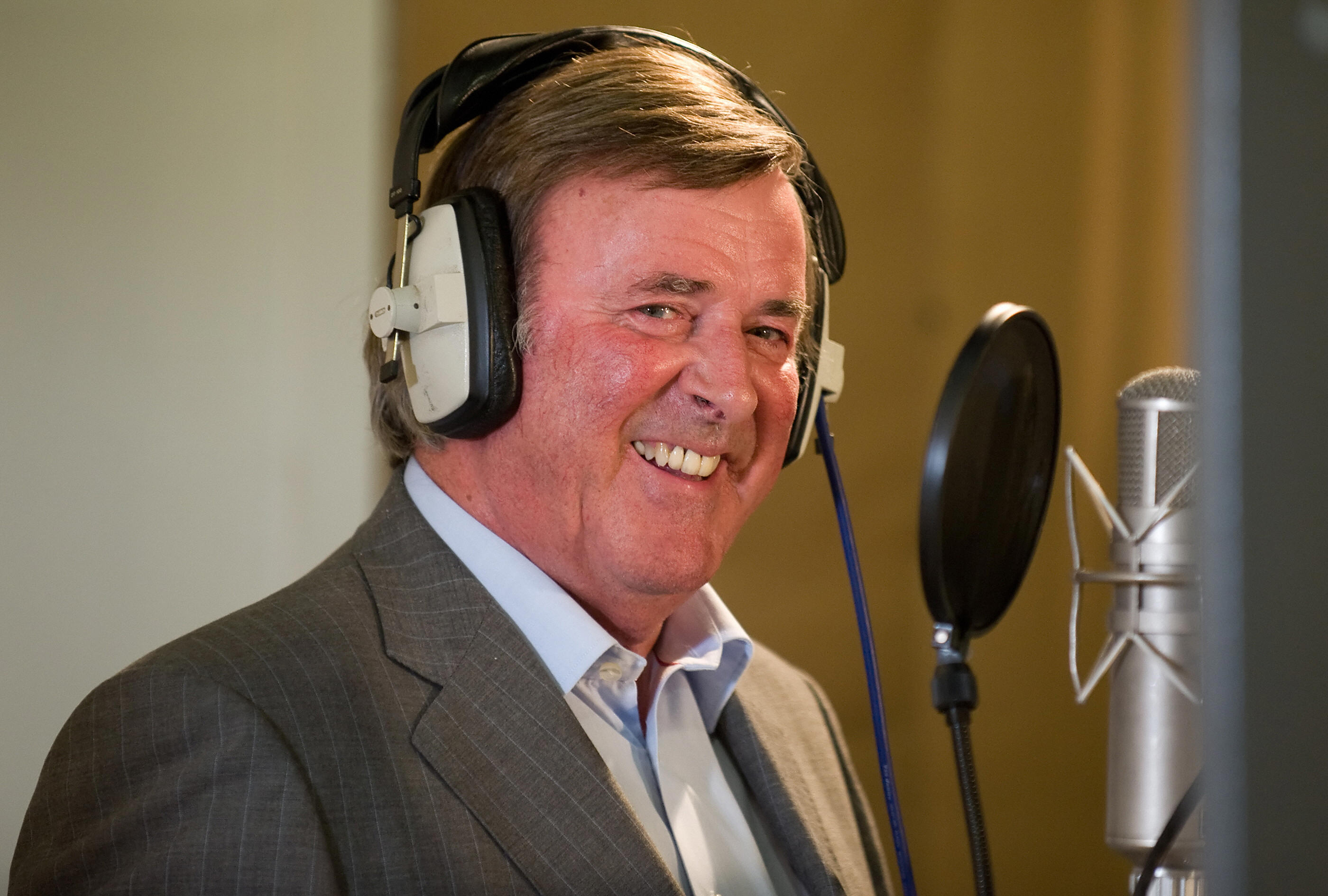 TV and radio presenter Terry Wogan takes part in a charity recording of a Children in Need album, joining forces with Pink Floyd drummer Nick Mason, ex-Rolling Stone Bill Wyman, singer Midge Ure and many others at Abbey Road studios, in west London, on September 7, 2009. Radio veteran Terry Wogan announced on Monday that he will be leaving Radio 2's breakfast show, the nation's most popular, and that he will be replaced by Chris Evans. Speaking live on air, the 71-year-old said the decision to leave Wake Up To Wogan at the end of the year was the hardest of his career. AFP PHOTO/Leon Neal (Photo credit should read Leon Neal/AFP/Getty Images)