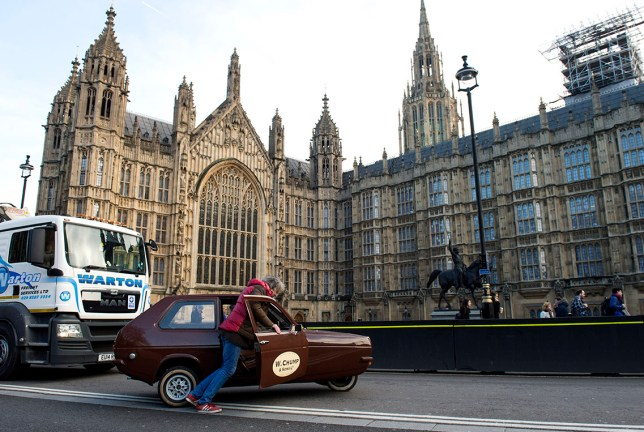 Image ©Licensed to i-Images Picture Agency. 18/02/2016. Westminster, United Kingdom. Former Top Gear presenter James May drives through Westminster in a Reliant Robin before the car suffered a mechanical fault and broke down outside of the houses of parliament in London, UK. Picture by Ben Stevens / i-Images