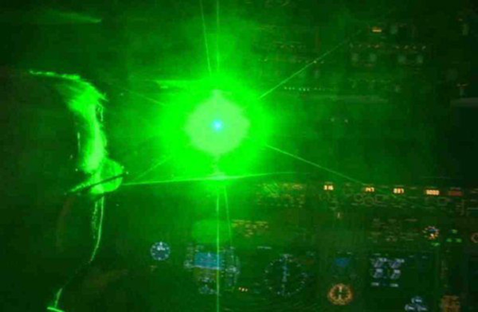 """This is what happens when a laser is shone at the cockpit of a passenger jet, police warned today 2/2/16. See NATIONAL copy NNLASER. Scotland Yard is currently investigating four incidents - the latest last Saturday - when lasers were shone at flights near Heathrow potentially dazzling the pilots. Officers stressed how dangerous it was to point lasers at incoming flights - and advised people to """"get another hobby."""" MPS Heathrow said: """"Endangering an aircraft in flight is a very serious offence. Maximum sentence is LIFE imprisonment."""""""