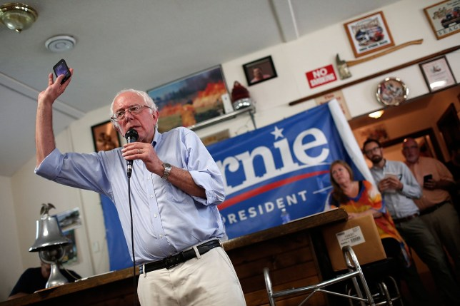 CLINTON, IA - AUGUST 16: Democratic presidential candidate U.S. Sen. Bernie Sanders (I-VT) holds up his mobile phone while answering a question about privacy issues at a campaign event at the IAFF Local 809 Union Hall August 16, 2015 in Clinton, Iowa. Sanders was scheduled for a full day of campaigning in eastern Iowa today. (Photo by Win McNamee/Getty Images)