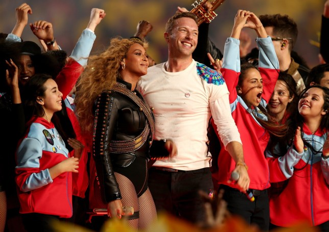 SANTA CLARA, CA - FEBRUARY 07: Beyonce (L) and Chris Martin of Coldplay perform onstage during the Pepsi Super Bowl 50 Halftime Show at Levi's Stadium on February 7, 2016 in Santa Clara, California. (Photo by Matt Cowan/Getty Images)