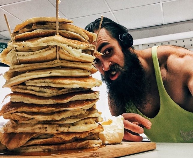 PIC FROM BEARDMEATSFOOD/CATERS NEWS - (PICTURED: Adam Moran a.k.a BeardMeatsFood with the huge stack of pancakes.)- This is the moment one determined competitive eater chomped down on a mammoth stack of pancakes - weighing in at a whopping 7lbs - and demolished the lot in under 20 minutes. Adam Moran, from Leeds, West Yorks, took on the monster challenge at My House Diner in Leeds - and he was the first person to ever complete it. Adam, 30, managed to polish off the pancakes with time to spare, finishing the gut-busting challenge in an impressive 18 minutes, 41 seconds.The mammoth challenge was no problem for Adam as he wolfed down the huge portion with ease - he is the UKs number one competitive eater. Otherwise known as Beard Meets Food, Adam has tackled competitive eating challenges all over the country- but this one nearly proved too much for even him. SEE CATERS COPY