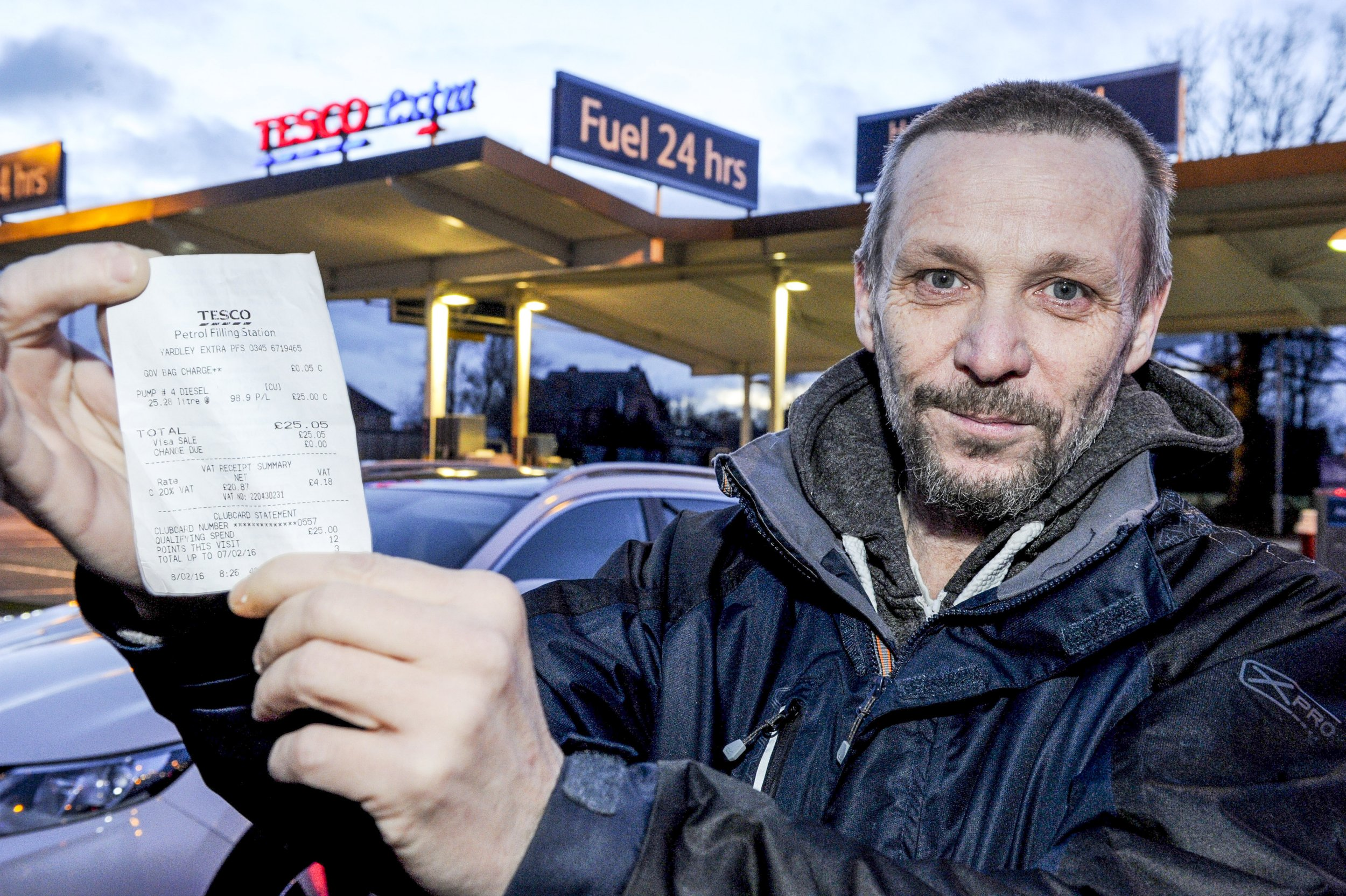 Tesco charged man 5p for carrier bag when he filled up car with petrol