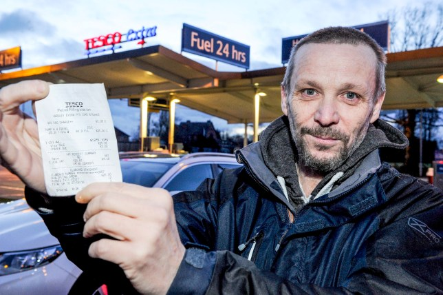 PIC BY KORAY EROL/MERCURY PRESS (PICTURED: JOHN GREEN WITH HIS BIZZARE RECEIPT FOR THE 5P GOVERNMENT BAG CHARGE WHEN HE ONLY BOUGHT DIESEL) A motorist was left stunned when he filled up his car with fuel ñ only for Tesco to slap him with a 5p carrier bag charge for it. John Green, 47, filled up his Nissan Qashqai with £25 diesel at Tesco Extra, in Yardley, Birmingham, yesterday morning but was left perplexed when his receipt showed he was charged £25.05. So confused by the error, the dad-of-three failed to realise where the extra 5p came from until he got home and noticed the bag charge. SEE MERCURY COPY