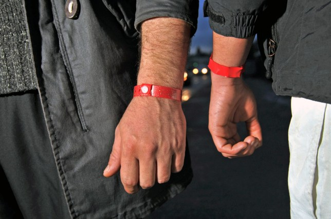 Asylum seekers having to wear red wrist bands in order to be served food at Lynx House, Newport Road, Cardiff.