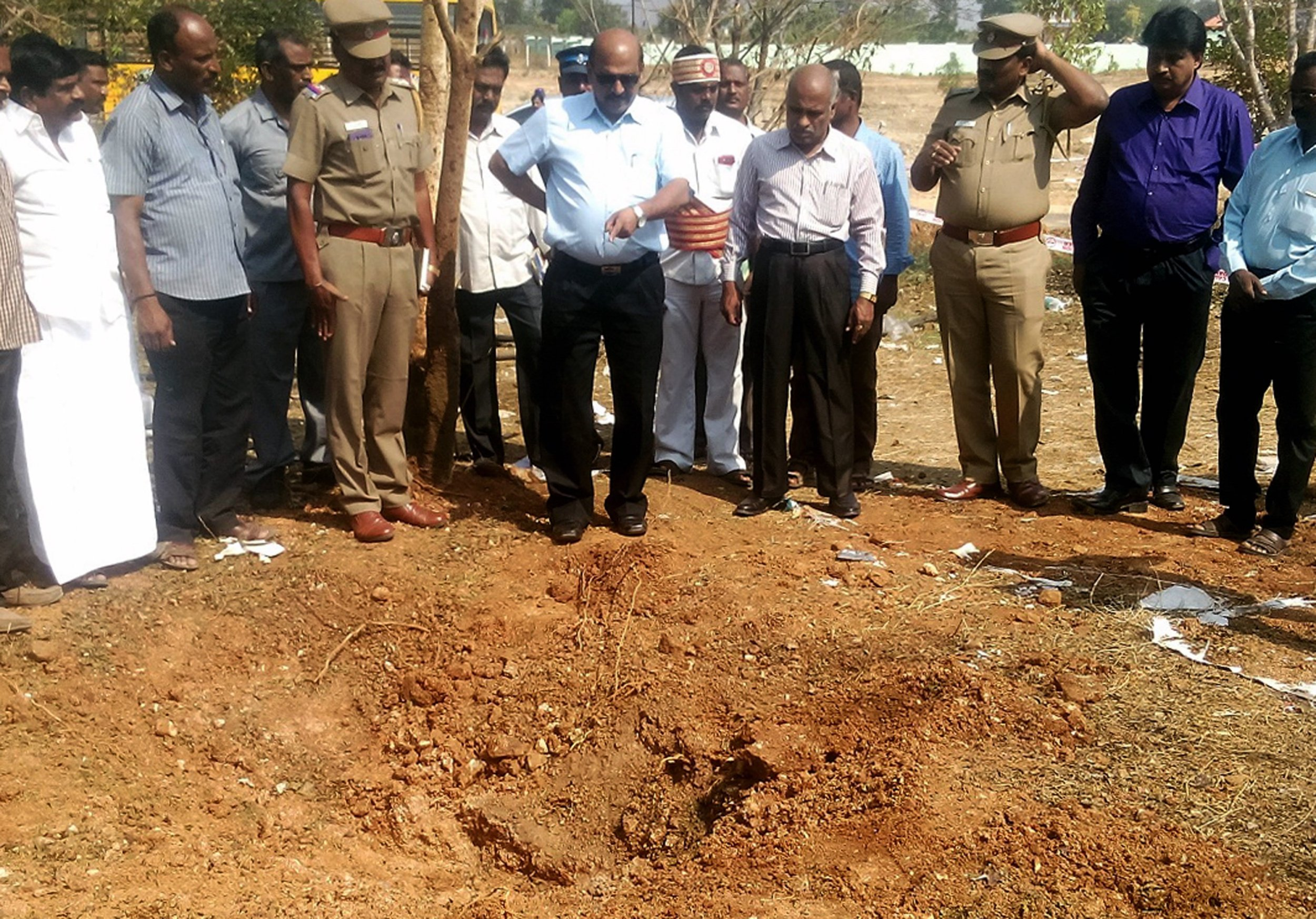 Indian authorities inspect the site of a suspected meteorite landing on February 7, 2016 in Vellore district in southern Tamil Nadu state in an impact that killed a bus driver and injured three others on February 6. If proven, it would be the first such death in recorded history. The impact of the object left a large crater in the ground and shattered window panes in a nearby building, killing the driver who was walking past. AFP PHOTOSTR/AFP/Getty Images