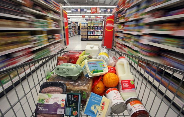 A shopping cart loaded with Sainsbury's-branded produce, is pushed through the company's supermarket in this arranged photograph in Stockport, U.K., on Wednesday, Oct. 5, 2011. J Sainsbury Plc, the U.K.'s third-biggest supermarket company, said second-quarter sales rose at the same pace as in the first three months of the year as shoppers bought more of its own-brand food ranges. Photographer: Chris Ratcliffe/Bloomberg via Getty Images
