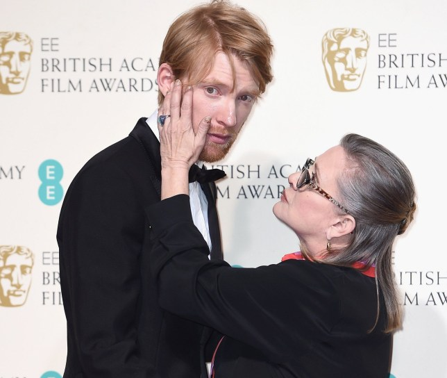 LONDON, ENGLAND - FEBRUARY 14: Domhnall Gleeson and Carrie Fisher pose in the winners room at the EE British Academy Film Awards at the Royal Opera House on February 14, 2016 in London, England. (Photo by Ian Gavan/Getty Images)