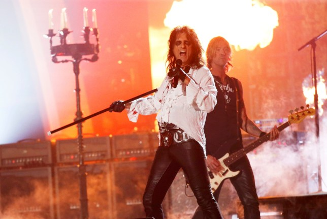 """Alice Cooper and Duff McKagan of the band Hollywood Vampires perform """"As Bad As I Am"""" during the 58th Grammy Awards in Los Angeles, California February 15, 2016. REUTERS/Mario Anzuoni"""