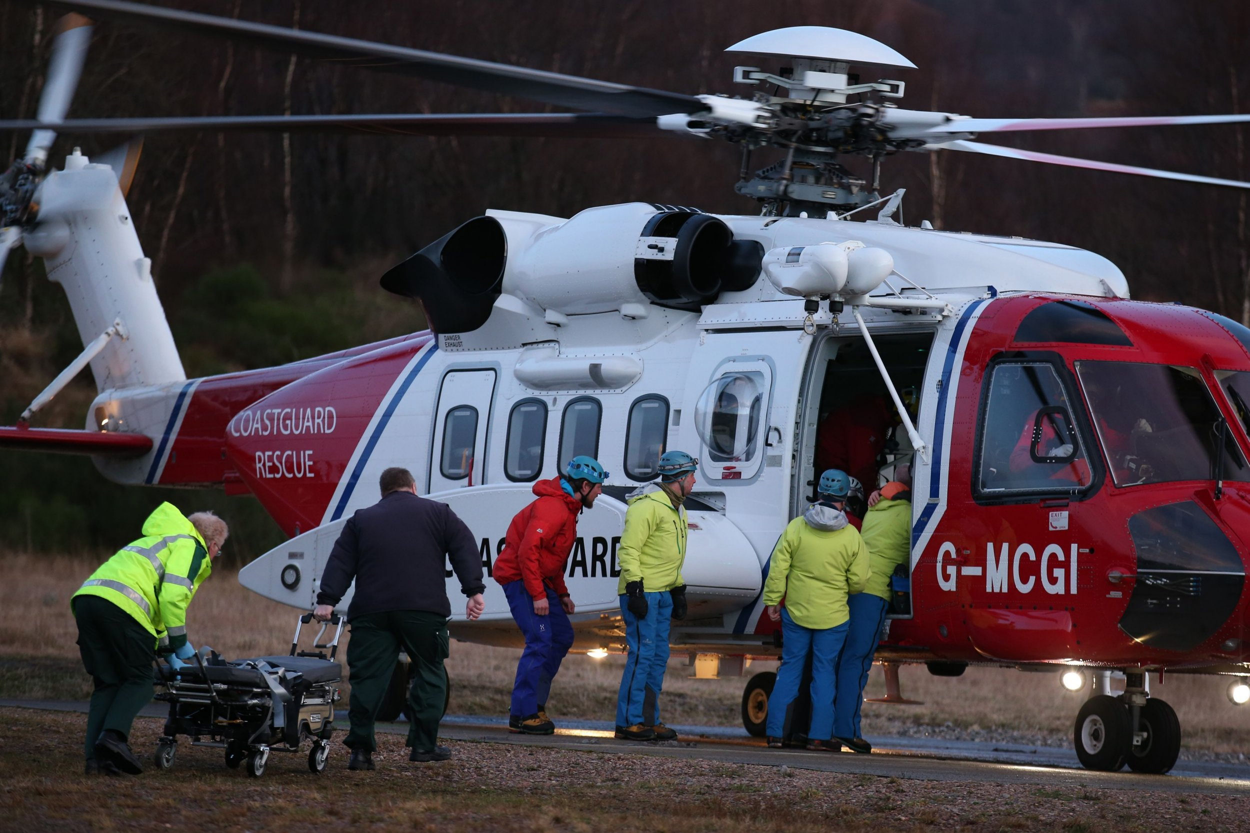 A casualty is taken from a search and rescue helicopter after an avalanche in the Creag Meagaidh area near Fort William. PRESS ASSOCIATION Photo. Picture date: Wednesday February 17, 2016. See PA story POLICE Avalanche. Photo credit should read: Andrew Milligan/PA Wire