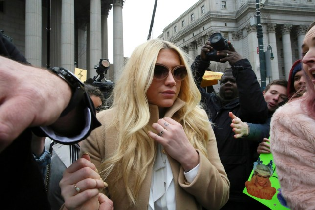 Pop star Kesha leaves Supreme court in New York, Friday, Feb. 19, 2016. Kesha is fighting to wrest her career away from a hitmaker she says drugged, sexually abused and psychologically tormented her _ and still has exclusive rights to make records with her. Producer Dr. Luke says the singer is slinging falsehoods and ruining his reputation to try to weasel out of her recording contract and strike a new deal. (AP Photo/Mary Altaffer)