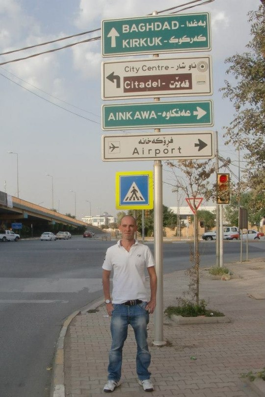 This guy goes onholidays to warzones. *** EXCLUSIVE - VIDEO AVAILABLE *** BAGDHAD, IRAQ - OCTOBER 2012: Andy pictured in the Iraqi capital on October 2012 in Bagdhad, Iraq. INTREPID adventurer Andy McGinlay believes he is the worldís most fearless traveller. While most of us are content with a package vacation or a relaxing beach break, the 34-year-old is on a one-man mission to holiday in the world's most dangerous countries. The teacher, who currently lives in Saudi Arabia, is addicted to extreme backpacking and has 'holidayed' in brutal regimes including North Korea, Syria, Iran, Iraq and Afghanistan. In 2010, the British daredevil took a much needed break in Syria but was arrested on suspicion of spying and was interrogated inside the military intelligence HQ. PHOTOGRAPH BY Andy McGinlay / Barcroft Media UK Office, London. T +44 845 370 2233 W www.barcroftmedia.com USA Office, New York City. T +1 212 796 2458 W www.barcroftusa.com Indian Office, Delhi. T +91 11 4053 2429 W www.barcroftindia.com