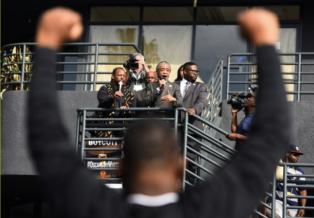 The Reverend Al Sharpton (C) speaks during a protest outside the 88th Academy Awards as a demonstrator holds up his hands in Hollywood, California February 28th, 2016.Sharpton led a group protesting the failure of the Academy Awards to recognize people of color in the major categories. REUTERS/Stuart Palley