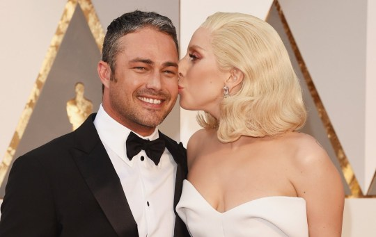 Recording artist Lady Gaga (R) kisses actor Taylor Kinney at the 88th Annual Academy Awards at Hollywood & Highland Center on February 28, 2016 in Hollywood, California. (Photo by Jason Merritt/Getty Images)