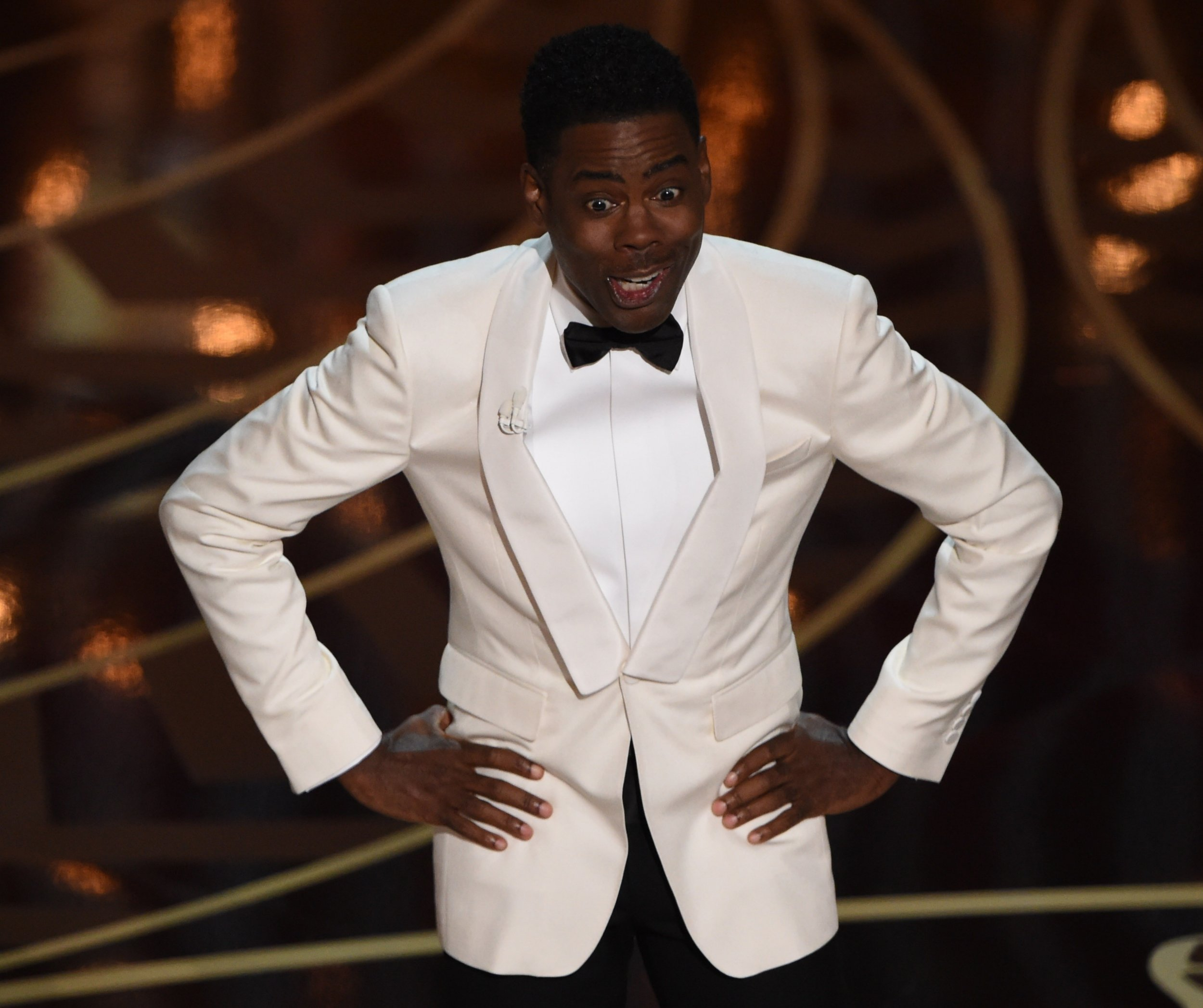Actor Chris Rock presents on stage at the 88th Oscars on February 28, 2016 in Hollywood, California. AFP PHOTO / MARK RALSTONMARK RALSTON/AFP/Getty Images